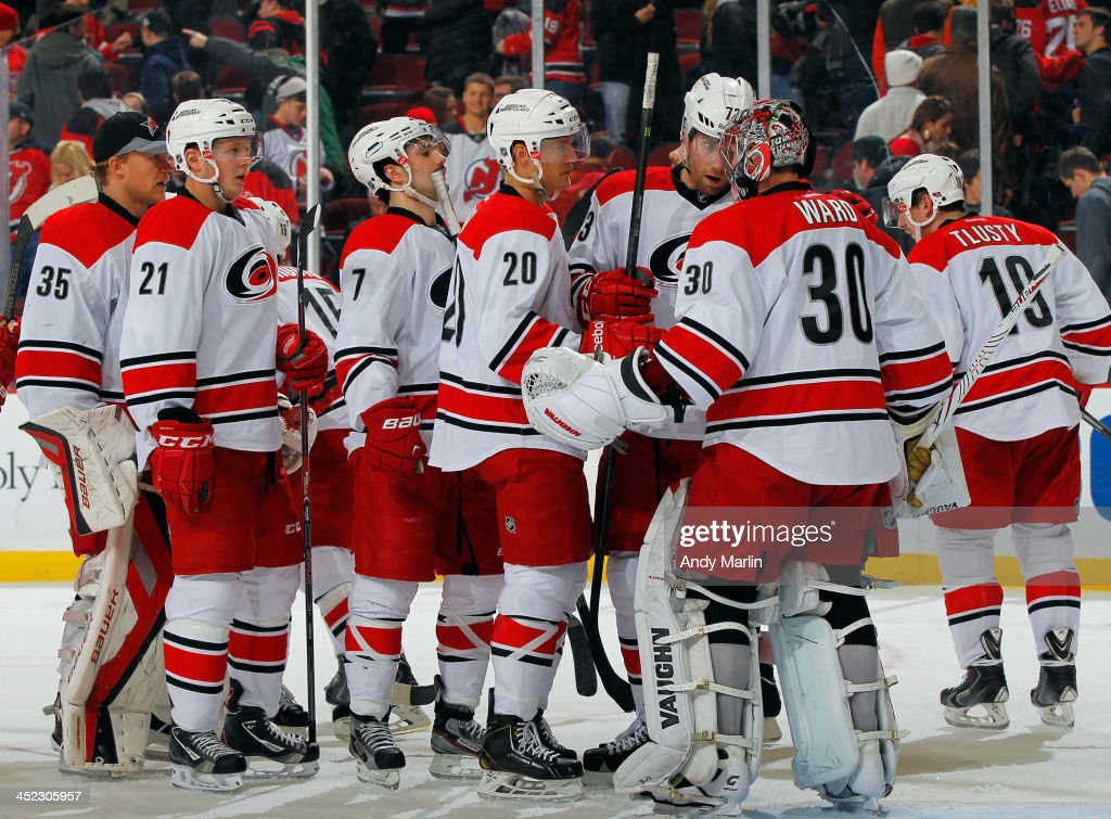 <a gi-track='captionPersonalityLinkClicked' href=/galleries/search?phrase=Cam+Ward&family=editorial&specificpeople=453216 ng-click='$event.stopPropagation()'>Cam Ward</a> #30 of the Carolina Hurricanes is congratulated by his teammates after defeating the New Jersey Devils at the Prudential Center on November 27, 2013 in Newark, New Jersey. The Hurricanes defeated the Devils 4-3.