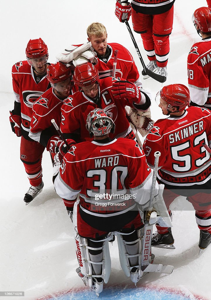 <a gi-track='captionPersonalityLinkClicked' href=/galleries/search?phrase=Cam+Ward&family=editorial&specificpeople=453216 ng-click='$event.stopPropagation()'>Cam Ward</a> #30 of the Carolina Hurricanes is congratulated by teammates on his shutout victory of the Winnipeg Jets during an NHL preseason game on September 25, 2011 at Time Warner Arena in Charlotte, North Carolina.