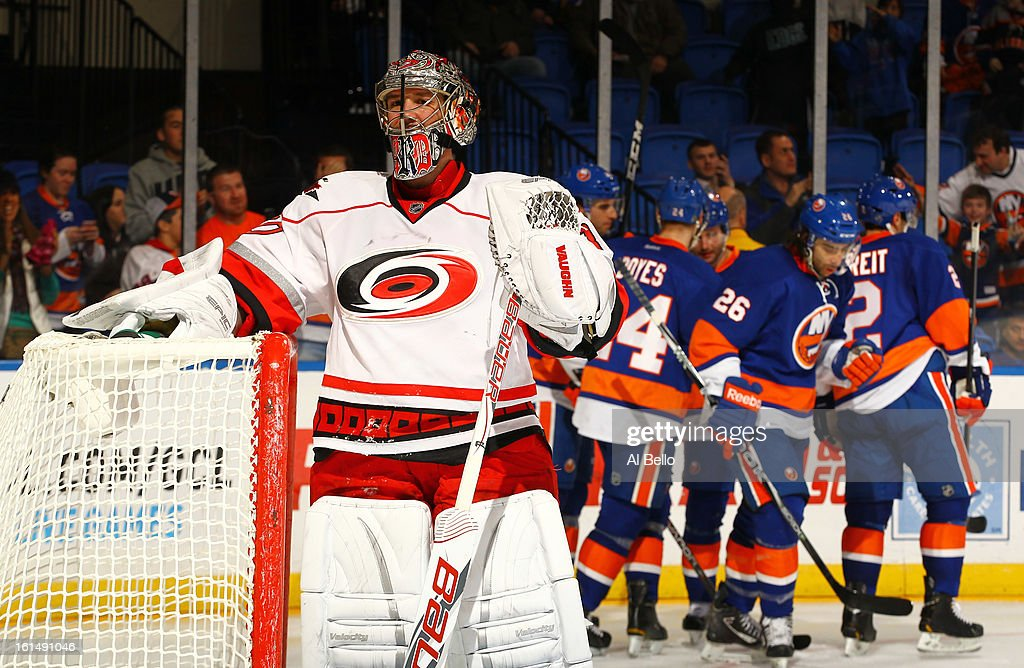 Cam Ward #30 of the Carolina Hurricanes looks on after giving up a goal to Matt Moulson #26 of the New York Islanders during their game at Nassau Veterans Memorial Coliseum on February 11, 2013 in Uniondale, New York.