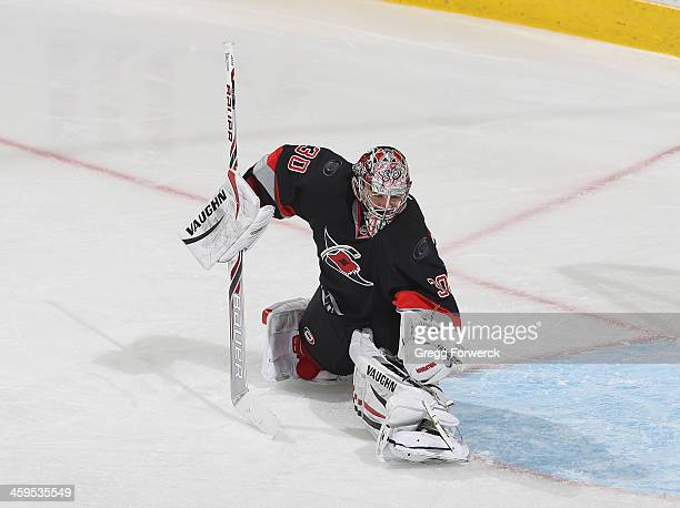 Cam Ward of the Carolina Hurricanes makes a glove save against of the Washington Capitals during their NHL game at PNC Arena on December 20 2013 in...