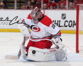 Cam Ward of the Carolina Hurricanes makes a leg pad save against the Detroit Red Wings during an NHL game on April 11 2014 at Joe Louis Arena in...