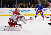 Cam Ward of the Carolina Hurricanes makes a save against the New York Rangers during their game at Madison Square Garden on November 30 2015 in New...