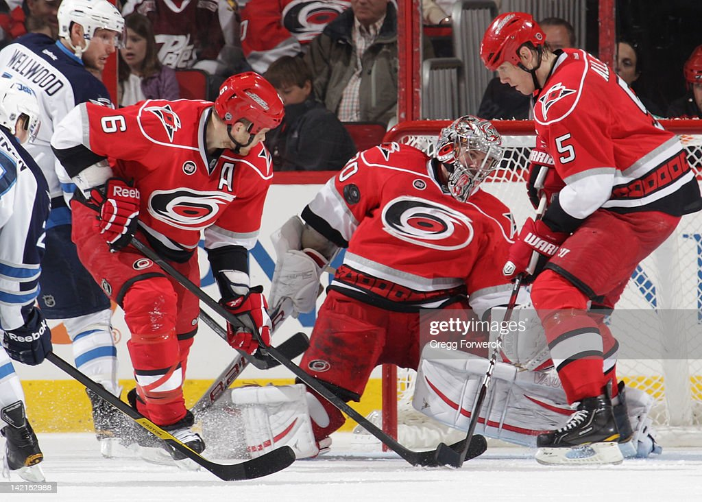 <a gi-track='captionPersonalityLinkClicked' href=/galleries/search?phrase=Cam+Ward&family=editorial&specificpeople=453216 ng-click='$event.stopPropagation()'>Cam Ward</a> #30 of the Carolina Hurricanes makes a save behind the defense of teammates <a gi-track='captionPersonalityLinkClicked' href=/galleries/search?phrase=Tim+Gleason&family=editorial&specificpeople=211575 ng-click='$event.stopPropagation()'>Tim Gleason</a> #6 and <a gi-track='captionPersonalityLinkClicked' href=/galleries/search?phrase=Bryan+Allen+-+Ice+Hockey+Player&family=editorial&specificpeople=206454 ng-click='$event.stopPropagation()'>Bryan Allen</a> #5 during an NHL game against the Winnipeg Jets on March 30, 2012 at PNC Arena in Raleigh, North Carolina.