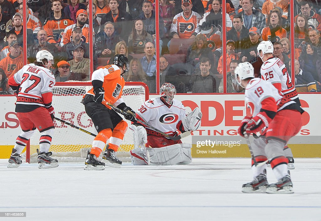 Cam Ward #30 of the Carolina Hurricanes makes a save during the game against the Philadelphia Flyers at the Wells Fargo Center on February 9, 2013 in Philadelphia, Pennsylvania.