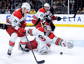 Cam Ward of the Carolina Hurricanes makes a save in front of Riley Nash during the second period at Staples Center on November 20 2014 in Los Angeles...