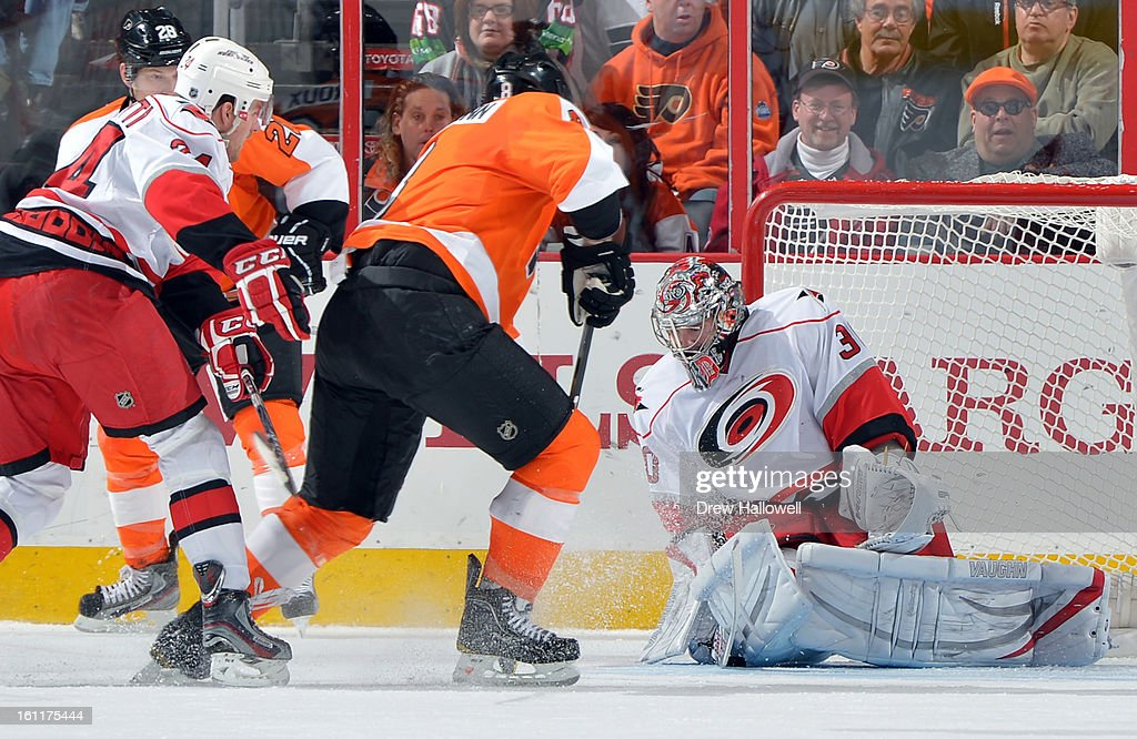 Cam Ward #30 of the Carolina Hurricanes makes a save on a shot by Nicklas Grossmann #8 of the Philadelphia Flyers at the Wells Fargo Center on February 9, 2013 in Philadelphia, Pennsylvania.