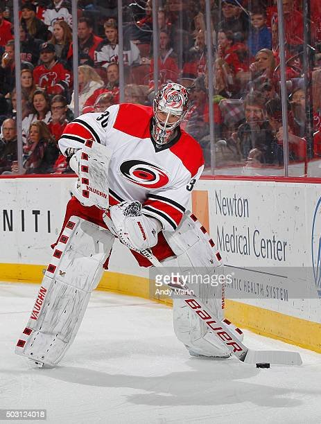 Cam Ward of the Carolina Hurricanes plays the puck against the New Jersey Devils during the game at the Prudential Center on December 29 2015 in...