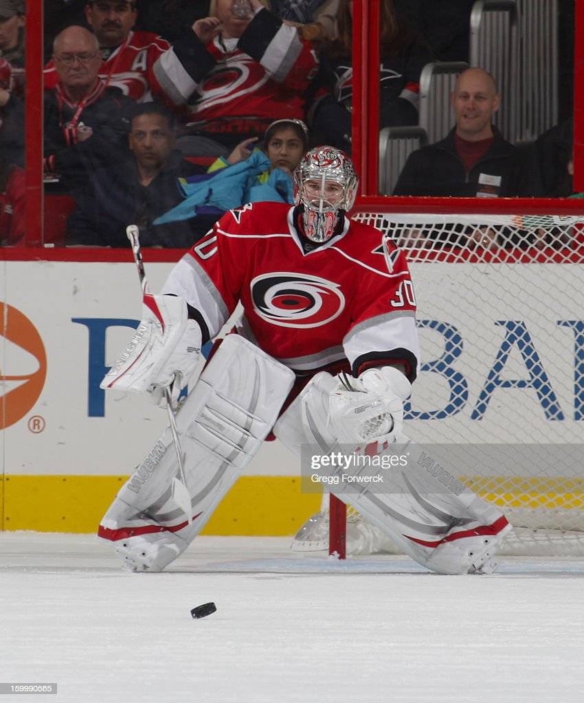 Cam Ward #30 of the Carolina Hurricanes prepares to play the puck against the Tampa Bay Lightning during their NHL game at PNC Arena on January 22, 2013 in Raleigh, North Carolina.