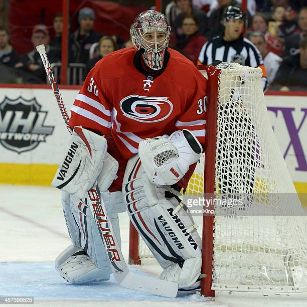 Cam Ward of the Carolina Hurricanes protects the net against the Vancouver Canucks at PNC Arena on December 1 2013 in Raleigh North Carolina