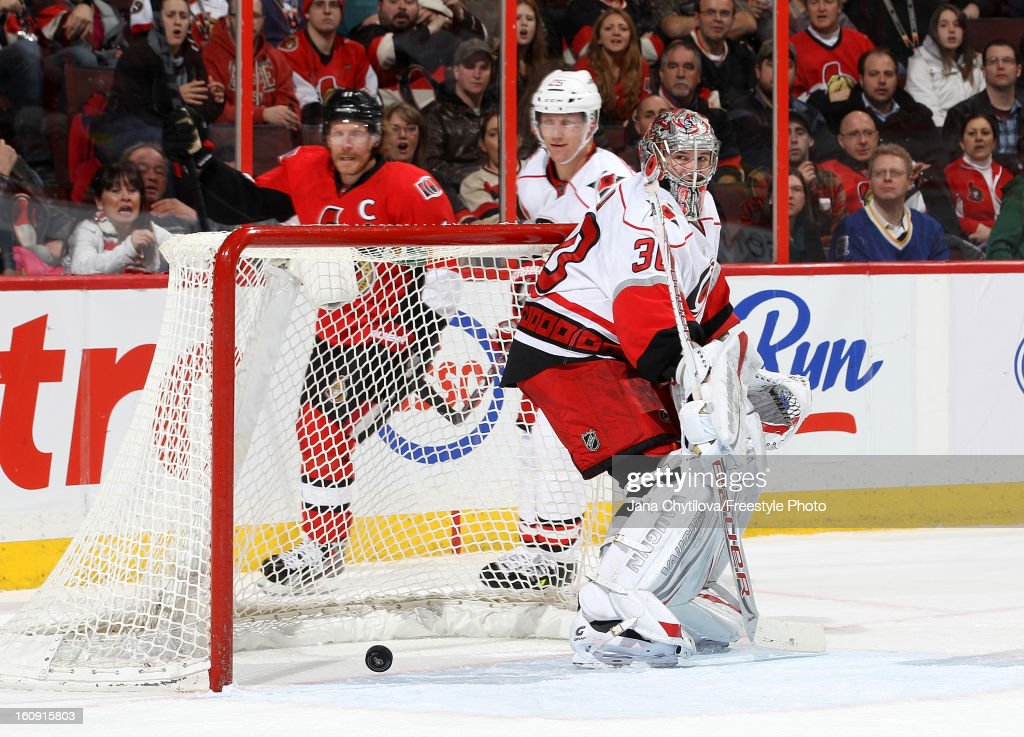 Cam Ward #30 of the Carolina Hurricanes reacts to a goal by Chris Neil #25 of the Ottawa Senators, during an NHL game at Scotiabank Place on February 7, 2013 in Ottawa, Ontario, Canada.