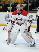 Cam Ward of the Carolina Hurricanes readies himself against the Nashville Predators at Bridgestone Arena on October 8 2015 in Nashville Tennessee