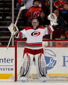 Cam Ward of the Carolina Hurricanes signals to his teammates in the first period against the New Jersey Devils at Prudential Center on November 27...