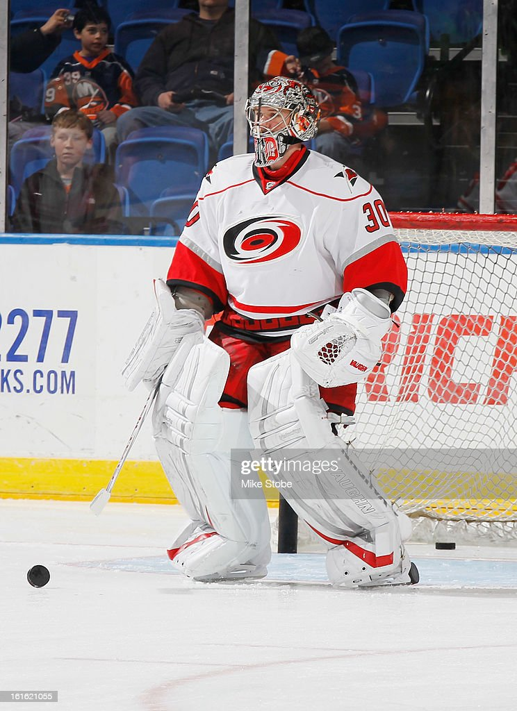Cam Ward #30 of the Carolina Hurricanes skates during warm-ups prior to the game against the New York Islanders at Nassau Veterans Memorial Coliseum on February 11, 2013 in Uniondale, New York. The Hurricanes defeated the Islanders 6-4.