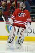 Cam Ward of the Carolina Hurricanes skates on the ice against the Vancouver Canucks at PNC Arena on December 1 2013 in Raleigh North Carolina