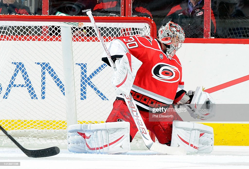 <a gi-track='captionPersonalityLinkClicked' href=/galleries/search?phrase=Cam+Ward&family=editorial&specificpeople=453216 ng-click='$event.stopPropagation()'>Cam Ward</a> #30 of the Carolina Hurricanes snares a shot from the St. Louis Blues during the inaugural NHL game at PNC Arena on March 15, 2012 in Raleigh, North Carolina.