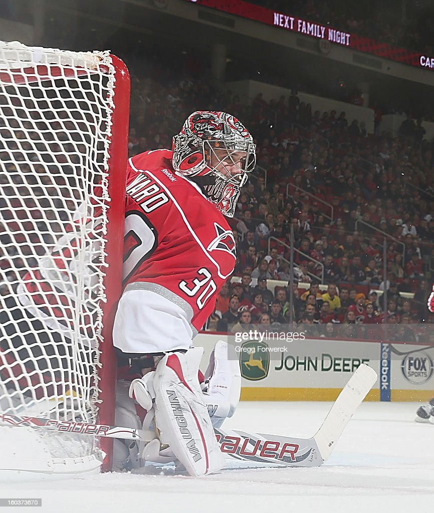Cam Ward #30 of the Carolina Hurricanes sqeezes tight against the pipe to protect the net during an NHL game against the Boston Bruins on January 28, 2013 at PNC Arena in Raleigh North Carolina.