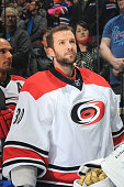 Cam Ward of the Carolina Hurricanes stands for the singing of the national anthem prior to a game against the Edmonton Oilers on October 24 2014 at...