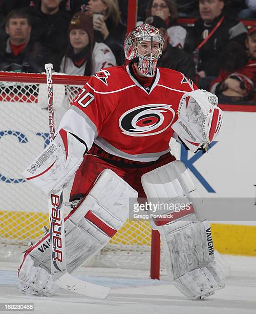 Cam Ward of the Carolina Hurricanes stands tall in the crease during their NHL game against the Buffalo Sabres at PNC Arena on January 24 2013 in...