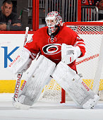 Cam Ward of the Carolina Hurricanes stands tall in the crease to protect the net during their NHL game against the New York Islanders at PNC Arena on...