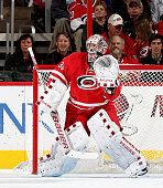 Cam Ward of the Carolina Hurricanes stands tall in the crease to protect the net during a NHL game against the Tampa Bay Lightning at PNC Arena on...