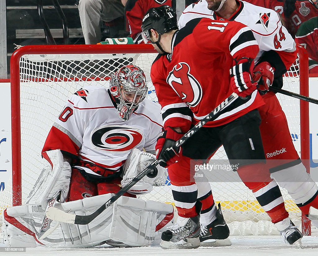 <a gi-track='captionPersonalityLinkClicked' href=/galleries/search?phrase=Cam+Ward&family=editorial&specificpeople=453216 ng-click='$event.stopPropagation()'>Cam Ward</a> #30 of the Carolina Hurricanes stops a shot by Stephen Gionta #11 of the New Jersey Devils at the Prudential Center on February 12, 2013 in Newark, New Jersey.The Carolina Hurricanes defeated the New Jersey Devils 4-2.