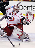 Cam Ward of the Carolina Hurricanes stops a shot in the first period against the Boston Bruins on November 26 2010 at the TD Garden in Boston...