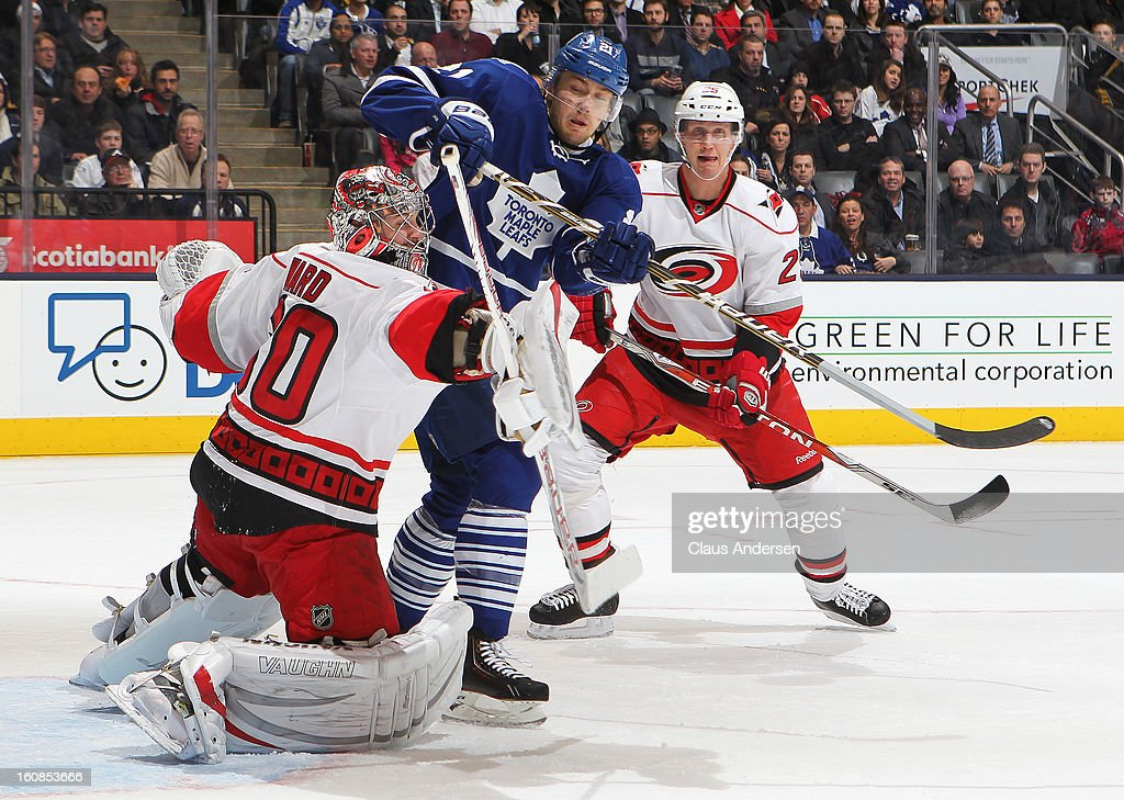 Cam Ward #30 of the Carolina Hurricanes stops an attempt by James van Riemsdyk #21 of the Toronto Maple Leafs in a game on February 4, 2013 at the Air Canada Centre in Toronto, Canada. The Hurricanes defeated the Leafs 4-1.