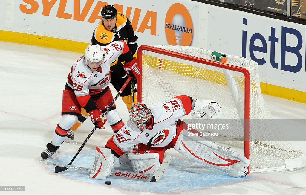<a gi-track='captionPersonalityLinkClicked' href=/galleries/search?phrase=Cam+Ward&family=editorial&specificpeople=453216 ng-click='$event.stopPropagation()'>Cam Ward</a> #30 of the Carolina Hurricanes stops the puck against the Boston Bruins at the TD Garden on February 2, 2012 in Boston, Massachusetts.