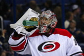 Cam Ward of the Carolina Hurricanes takes a drink of water during a time out in the game against the Columbus Blue Jackets on September 26 2013 in a...