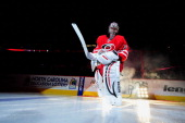 Cam Ward of the Carolina Hurricanes takes the ice before the team's home opener against the Detroit Red Wings at PNC Arena on October 4 2013 in...