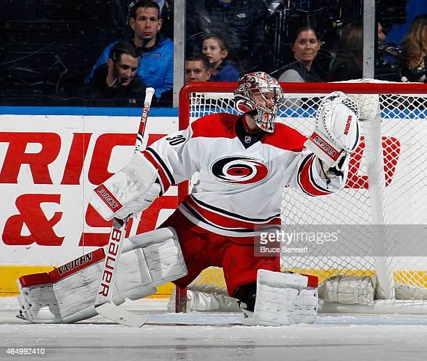 Cam Ward of the Carolina Hurricanes tends net against the New York islanders at the Nassau Veterans Memorial Coliseum on February 28 2015 in...