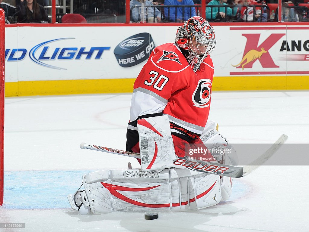 <a gi-track='captionPersonalityLinkClicked' href=/galleries/search?phrase=Cam+Ward&family=editorial&specificpeople=453216 ng-click='$event.stopPropagation()'>Cam Ward</a> #30 of the Carolina Hurricanes watches a puck sail by during an NHL game against the St. Louis Blues on March 15, 2012 at PNC Arena in Raleigh, North Carolina.