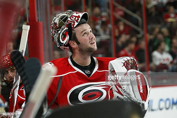 Cam Ward of the Carolina Hurricanes watches highlights on the jumbotron during a timeout of a NHL game against the Dallas Stars on December 16 2009...