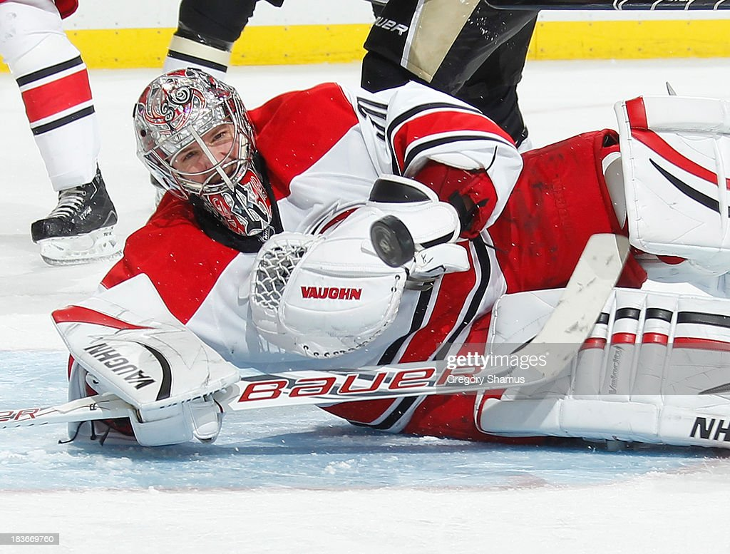 <a gi-track='captionPersonalityLinkClicked' href=/galleries/search?phrase=Cam+Ward&family=editorial&specificpeople=453216 ng-click='$event.stopPropagation()'>Cam Ward</a> #30 of the Carolina Hurricanes watches the loose puck during the third period against the Pittsburgh Penguins on October 8, 2013 at Consol Energy Center in Pittsburgh, Pennsylvania.