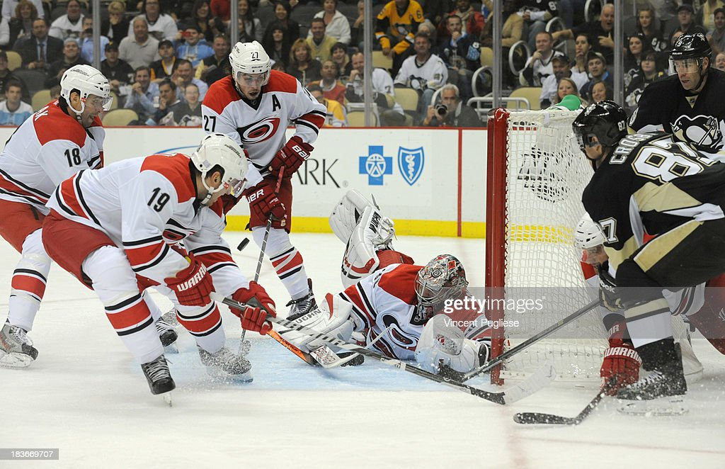 <a gi-track='captionPersonalityLinkClicked' href=/galleries/search?phrase=Cam+Ward&family=editorial&specificpeople=453216 ng-click='$event.stopPropagation()'>Cam Ward</a> #30 of the Carolina Hurricanesmakes a diving save of off a shot by <a gi-track='captionPersonalityLinkClicked' href=/galleries/search?phrase=Sidney+Crosby&family=editorial&specificpeople=212781 ng-click='$event.stopPropagation()'>Sidney Crosby</a> #87 of the Pittsburgh Penguins during the third period on October 8, 2013 at the CONSOL Energy Center in Pittsburgh, Pennsylvania.