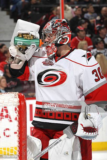 Cam Ward the Carolina Hurricanes takes a drink of water in a game against the Ottawa Senators at Scotiabank Place on December 29 2010 in Ottawa...
