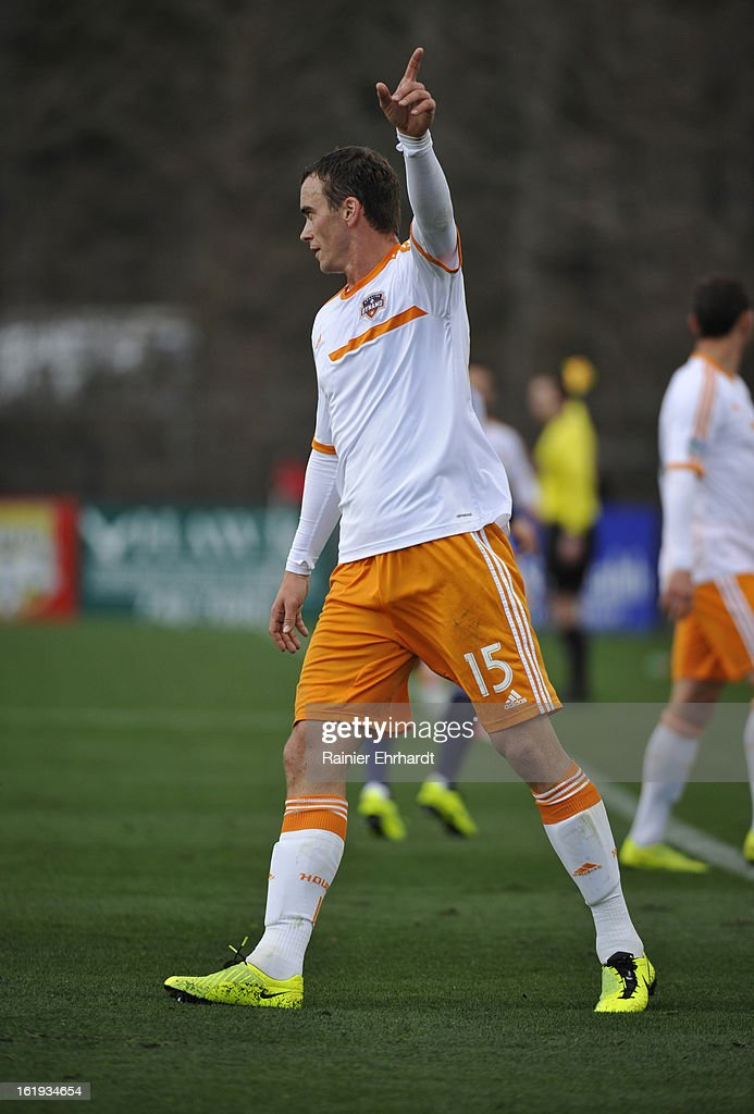 Cam Weaver #15 of the Houston Dynamo gestures during the first half of their game against the Chicago Fire at Blackbaud Stadium on February 16, 2013 in Charleston, South Carolina.
