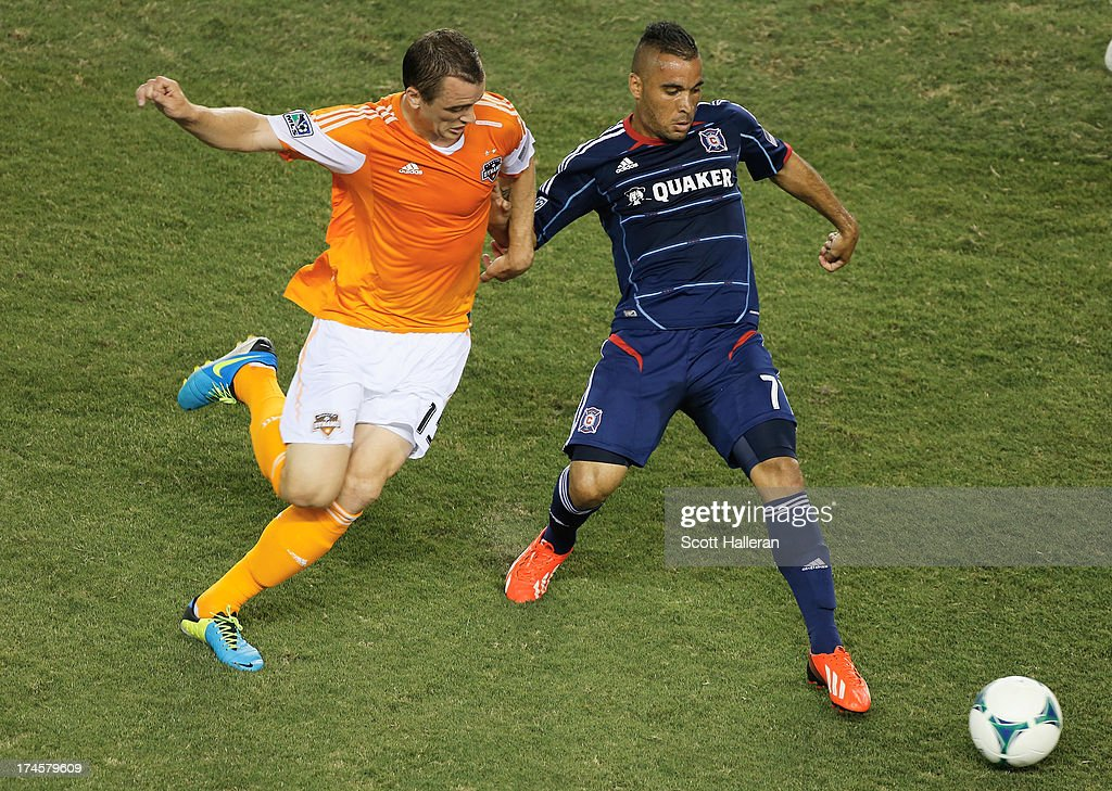 Cam Weaver #15 of the Houston Dynamo works the ball against Alex #71 of the Chicago Fire at BBVA Compass Stadium on July 27, 2013 in Houston, Texas.