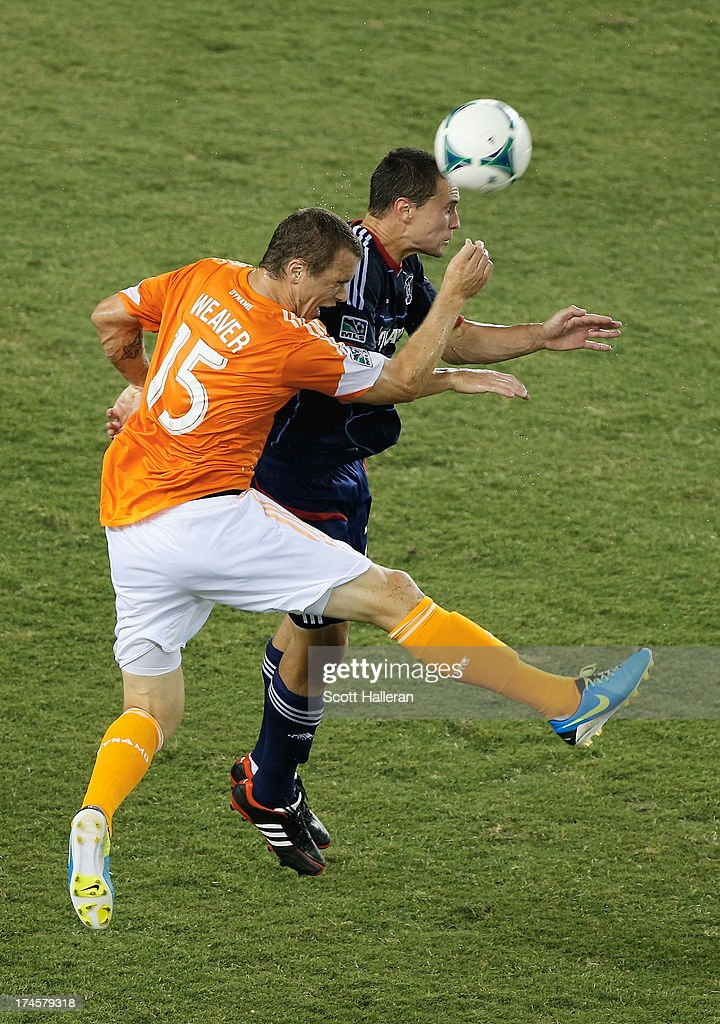 Cam Weaver #15 of the Houston Dynamo works the ball against Austin Berry #22 of the Chicago Fire at BBVA Compass Stadium on July 27, 2013 in Houston, Texas.