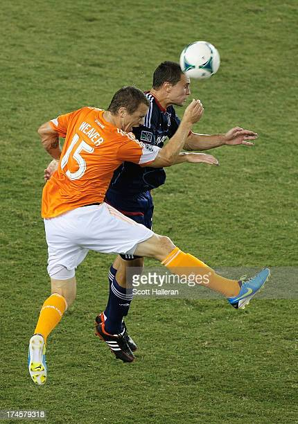 Cam Weaver of the Houston Dynamo works the ball against Austin Berry of the Chicago Fire at BBVA Compass Stadium on July 27 2013 in Houston Texas