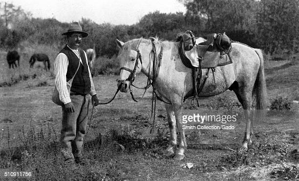 Camargue cowboy standing with his horse France 1922