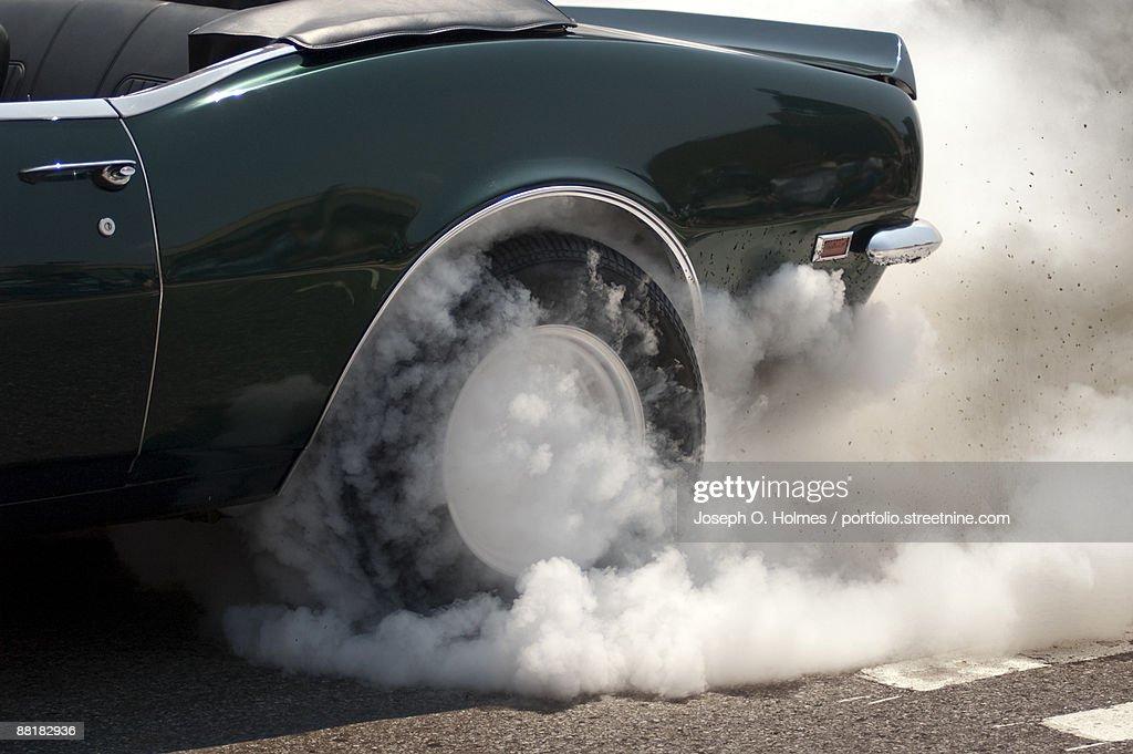 Camaro smoking tire