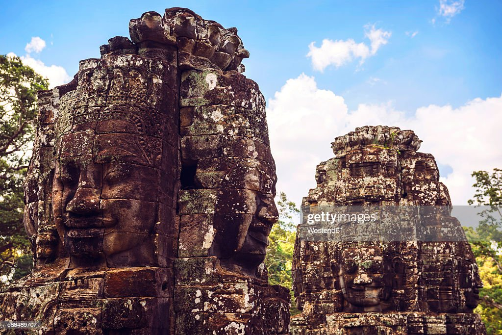 Cambodia, Angkor Thom, stone head on towers of Bayon temple