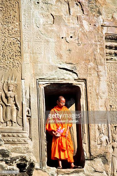Cambodia Siem Reap Angkor Wat Buddhist monk in traditional saffron robe
