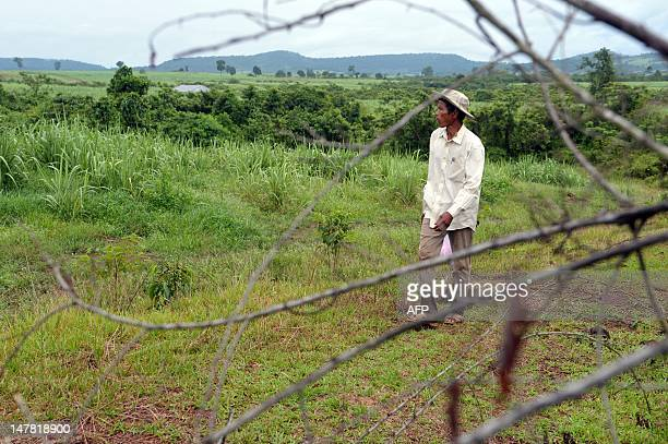 CambodiaagriculturesugareconomytradeFOCUS by Suy Se This photo taken on May 17 2012 shows Cambodian community leader Teng Kao walking at a sugarcane...