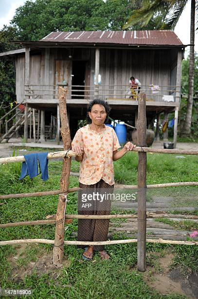CambodiaagriculturesugareconomytradeFOCUS by Suy Se This photo taken on May 17 2012 shows Cambodian Yi Chhav a 68yearold widow standing in front of...