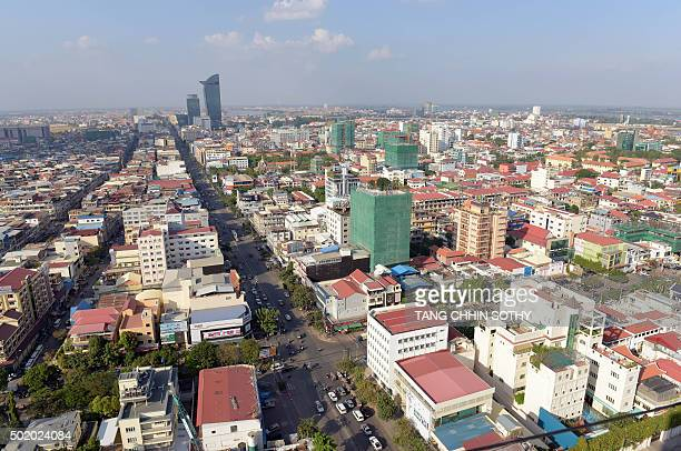 CambodiaeconomyarchitectureFEATURE by Suy Se This photo taken on December 15 2015 shows an overhead view of Phnom Penh From glitzy malls and highrise...
