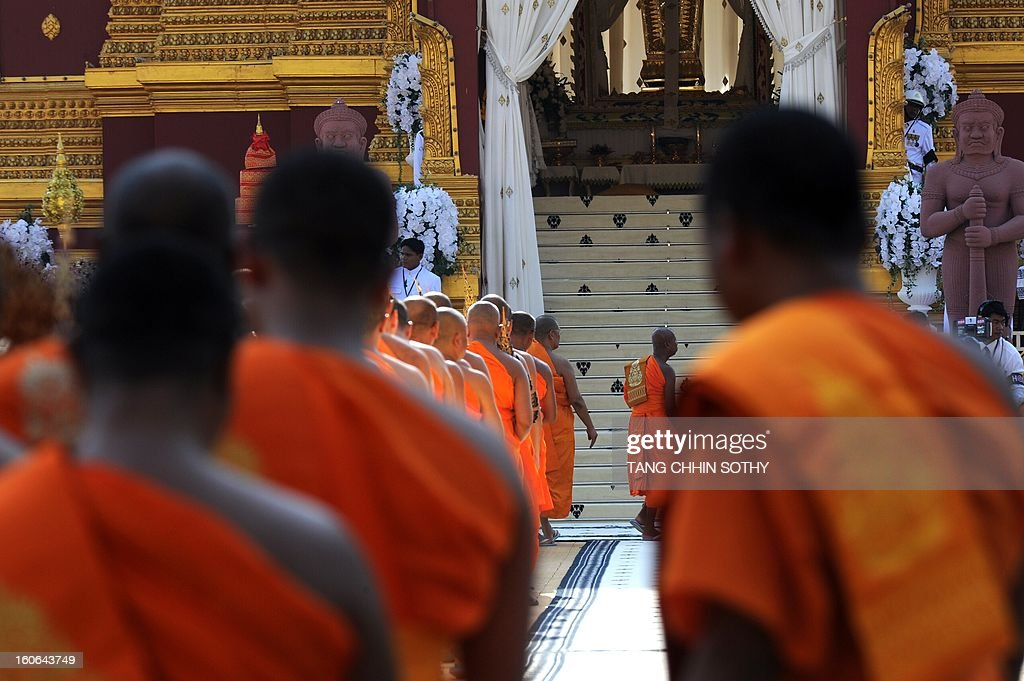 Cambodian Buddhist monks line up at the cremation site during the cremation of Cambodia's King Norodom Sihanouk near the Royal Palace in Phnom Penh on February 4, 2013. Thousands of mourners massed in the Cambodian capital as the kingdom cremated its revered former King Norodom Sihanouk, who steered his country through six turbulent decades.