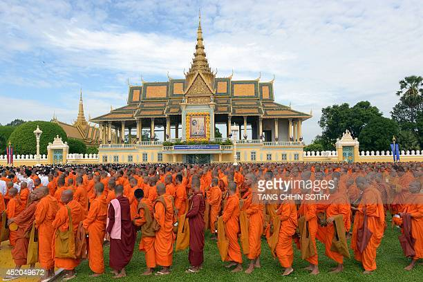 Cambodian Buddhist monks line up during a Buddhist ceremony in front of the Royal Palace in Phnom Penh on July 12 2014 In line with former king...