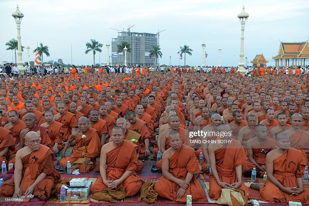 Cambodian Buddhist monks pray for the late former King Norodom Sihanouk in front of the Royal Palace in Phnom Penh on October 20 2012 after the...